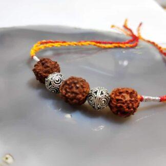 Sterling Silver Beads and Three Rudraksh Rakhi Side