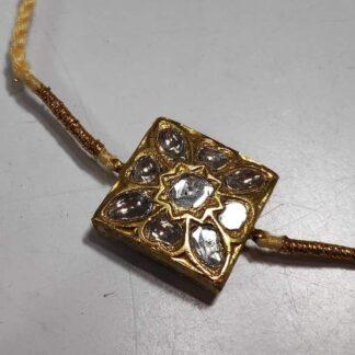 Gold Rakhi with Kundan Work and Decorative Back flower