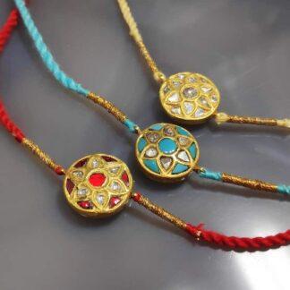 Gold Rakhi with Diamond and Gemstone Kundan Work (Set of 3)
