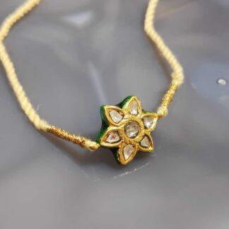Love Blooms Floral Rakhi in 22K Gold & Kundan with uncut Diamonds Main